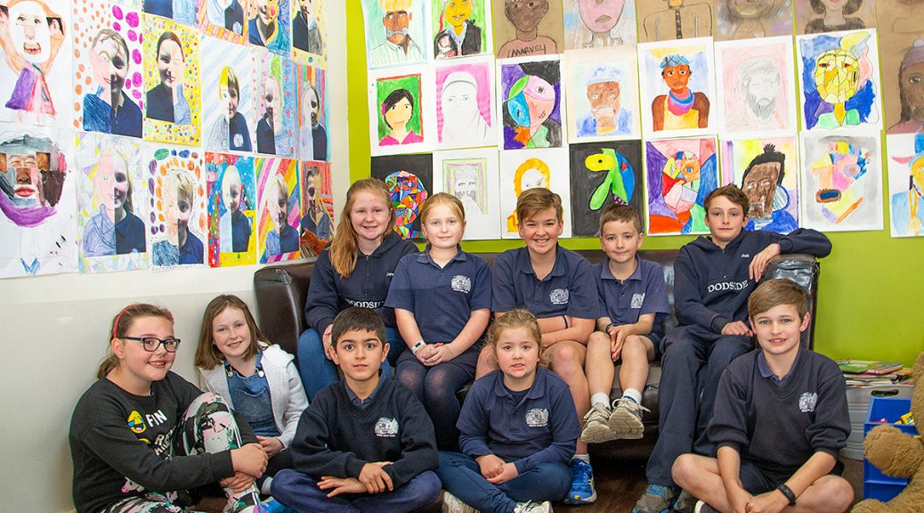 Students from the Woodside Primary School amid their SALA exhibition at the Olive Branch Café, Balhannah.