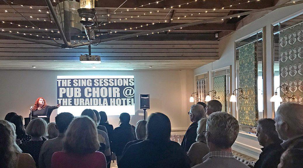Jennifer DeGrassis leading the Uraidla Sing Sessions Pub Choir at the Uraidla Hotel
